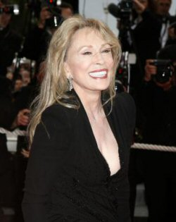 Faye Dunaway, looking great at 67 (although the porcelain covered Chiclet teeth 'bout like to blind me).