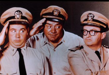 L-R: Tim Conway as Ensign Parker, Ernest Borgnine as McHale, and Joe Flynn as Capt. Binghamton