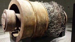 An elevator motor with its wiring completely frayed.