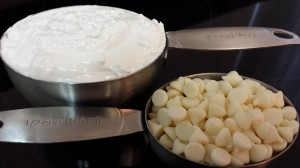"""Melt the marshmallow creme and """"white chocolate"""" together, and pour over the hardened initial layer."""